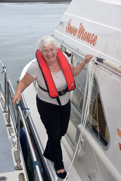 Evelyne onboard Snow Mouse as it makes its way to the channel leading to Kilrush Marina.