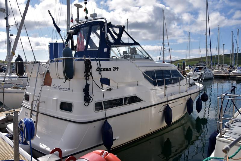 Cool Runnings in her berth alongside Arthur in Dingle Marina.