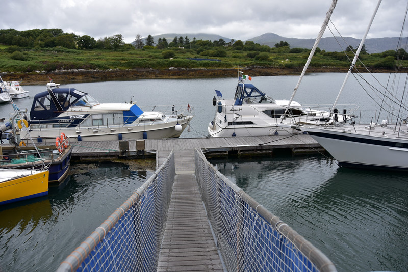 """Arthur"" (left) and Cool Runnings (right) at bottom of gangway to main jetty at Lawrence Cove Marina."