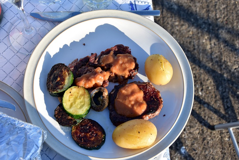 Rib-eye steak with homemade BBQ sauce and some zucchini (courgette) and new potatoes.