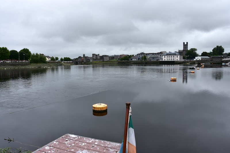 """Looking astern ...the weir is just about visible a couple of feet to the left of the yellow buoys. At high-water the weir will be covered with sufficient water to enable """"Arthur"""" to cross over and proceed under Sarsfield Bridge."""