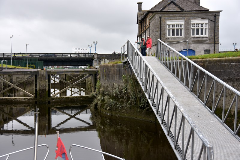 """""""Arthur"""" at the floating jetty at the entrance to Sarsfield Lock. Mary with Pat Lysaght at top of gangway."""
