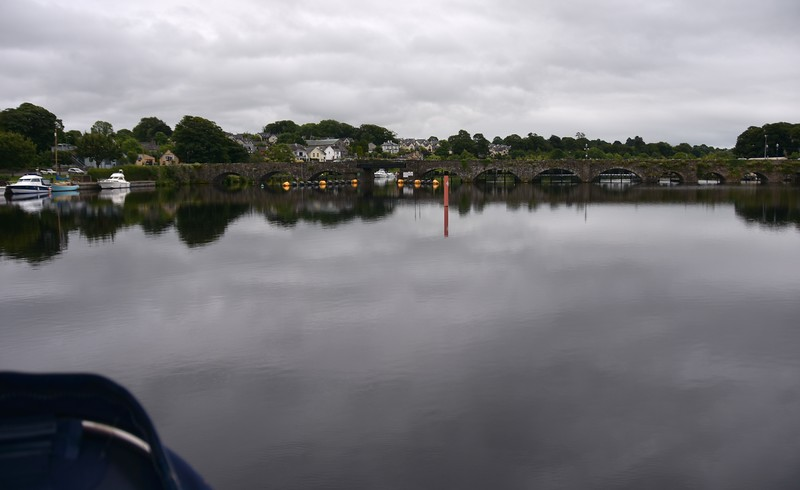 "And so ""Arthur"" makes her way towards the bridge at Killaloe, one of the lowest on the inland waters, as she heads for Ardnacrusha. So, I hear you wonder...'Why leave Killaoe at such an early hour in the morning?'.<br /> <br /> Well, you remember the weather window...it ends circa 19:00hrs. So we plan to be in Kilrush by that time. The passage from Limerick to Kilrush takes us approx. 4hrs 30 mins. This means we need to depart Limerick circa 14:30. However we have to get into Limerick and need to do that BEFORE high-tide. The table on the next slide shows the High-tide times for the month of July. Find 3rd July and note the entries (morning and afternoon) for High-tide (Ht)."