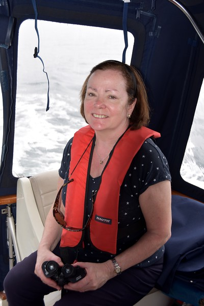 "12:45...With that happy smile on her face, Mary must have just spotted a dolphin(s). It has always been the case with ""Arthur"" that anytime we encounter dolphin(s) during a passage that we have a safe trip! Always!"