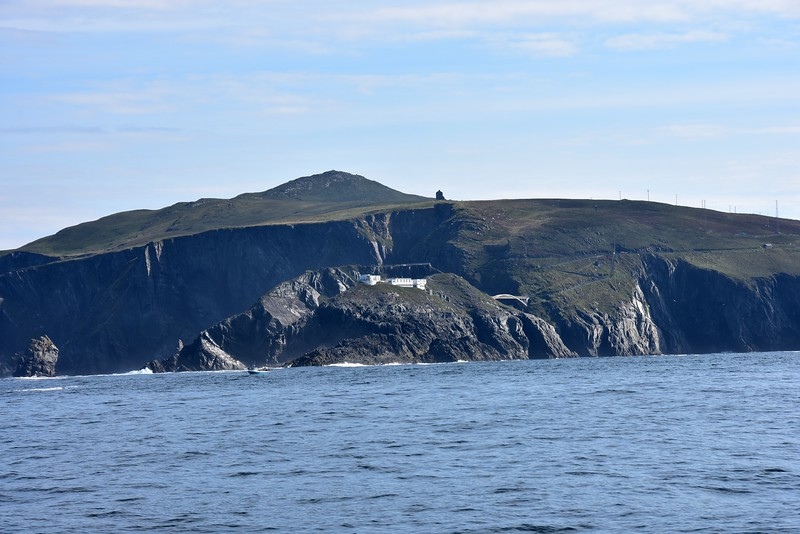 "09:45...""Arthur"" passing Mizen Head. Note lighthouse built into headland and the footbridge which connects to the mainland."