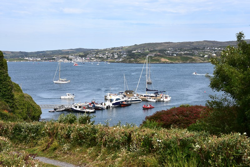 "View of the Sherkin Island Marina. ""Arthur"" now re-located on the inside rather than on the hammerhead which was hugely susceptible to wake from boats, particularly RIBs and powerboats, either arriving at the marina or passing by!"
