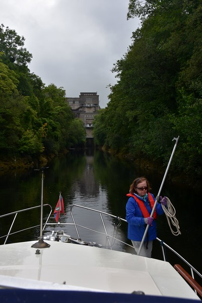 "09:08...Marty gets her gear ready to negotiate the lower chamber at Ardnacrusha. We always use a short rope to secure ""Arthur"" as we negotiate the two chambers at Ardnacrusha. And a boat hook is also a necessity."