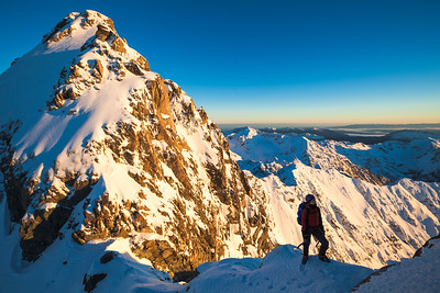 Mountaineer between High and Middle peaks of Mount Rolleston