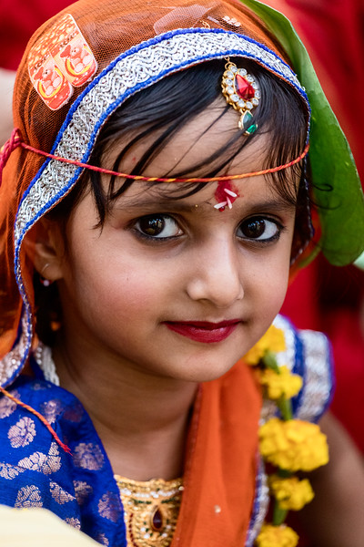"This beautiful young girl belonged to one of the dozens of ""wedding parties"" eager for their photographs to be taken during the Ganguar celebration in Jaipur, India. [SEEK OUT FESTIVALS AND CELEBRATIONS section, fourth paragraph, page 36]"