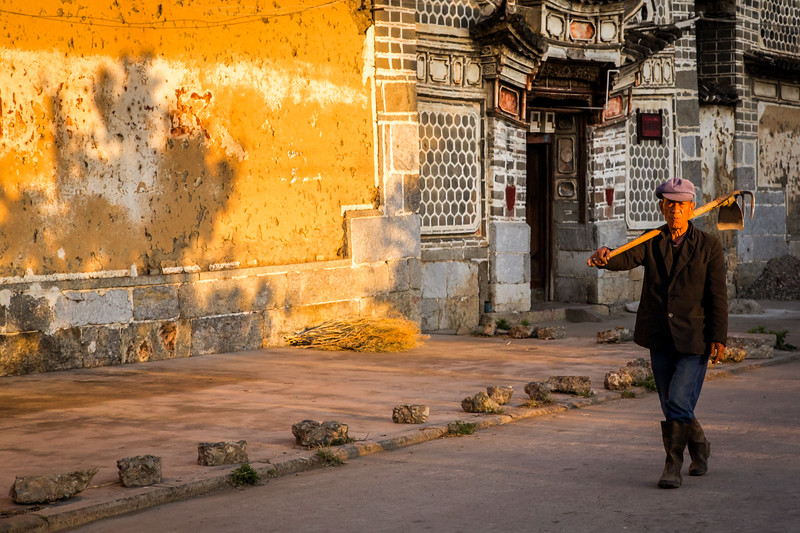 This vantage point was one of my favorites for pre-breakfast village shooting sessions in Xizhou, China. The worker, the light and background make a fine combination. [IN FOREIGN TERRITORY, ARRANGE A LOCAL GUIDE section, fourth paragraph, page 39]