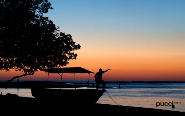 Costa Rica Happiest country fisherman sunset Pucci Howler
