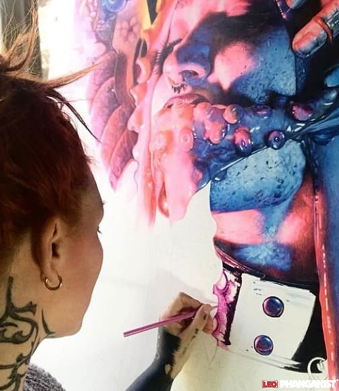 Working on her largest piece to date