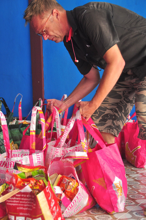 Ole Norheim, founder of Happy Food, prepare Happy Bags for later distribution.
