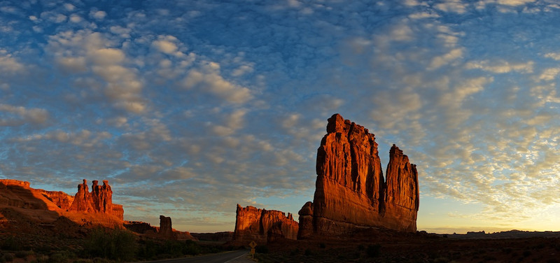 "Courthouse Towers at Sunrise - Arches National Park, Utah<br /> <br /> Link To Original Image:  <a href=""http://www.tom-hill.biz/Galleries/Scenics/Utah/20957775_CZGg5B#!i=1726113116&k=stmCTvZ"">http://www.tom-hill.biz/Galleries/Scenics/Utah/20957775_CZGg5B#!i=1726113116&k=stmCTvZ</a><br /> __________<br /> <br /> If you're new to digital photography you might already know there are a million compromises to deal with when out in the field.  It all has to do with the limitations of your equipment meaning your camera does not see what you eye sees, which might be a surprise to you.  Today's topic is about one of those limitations.  We're going to talk about dynamic range.<br /> <br /> Dynamic range is the breadth of luminance from very dark to white bright.  This breadth is usually measured with a thing called Exposure Value (EV) or if you're old school, in F-Stops.  Essentially the increase in brightness--i.e. luminance--on a dark gray object to one that's ""twice as bright"" increases it's EV by one or a single F-Stop.  For two EV's it's a double double or 4 times the light increase.<br /> <br /> According to Wikipedia the human eye with it's brain involved and various other chemical reactions can discern about 20 stops or about a million times the light increase.  I've heard the number about 11 stops, which seems to make more sense.  Still it's a huge number.  If you're wondering, your camera probably does about 5 stops meaning whatever your camera sees is not nearly what your eye can do.  So begins the quest to get more than your equipment will allow.<br /> <br /> The technique we're talking about today is HDR.  I have an article about what HDR means: <br /> <br /> (link:  <a href=""http://www.tom-hill.biz/Articles/Image-Processing/What-Is-HDR/21543728_ddX5sf#!i=1717604291&k=8NTVZcF"">http://www.tom-hill.biz/Articles/Image-Processing/What-Is-HDR/21543728_ddX5sf#!i=1717604291&k=8NTVZcF</a>)<br /> <br /> The basic premise of HDR is collecting two or more exposure values of the same scene then merging them together using software back at home.  In the example I'm using today, I collected two sets of exposures separated by two stops--or four times the light.<br /> <br /> The technique I'm teaching here uses Photoshop and it's layers and mask features.  If you're familiar with these you can easily understand what I'm about to introduce.<br /> <br /> The idea is you stack one exposure on top of the other then use a mask to mask out portions of the upper layer to reveal the lower one.  The technique I'm teaching here is you'll be stacking layers with the bottom most the darkest layer with the upper one a bit lighter.  In this case, the dark layer has the best highlights.  The upper layer has the best shadows.  The goal is to build a mask that allows the best highlights--the sunrise--to come through while preserving the best shadows."