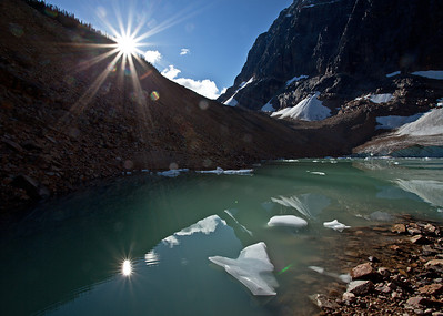 At Mount Edith Cavell the earth is massive and imposing. Smooth white glaciers contrast the jagged orangey brown moraine and the rock and ice are reflected by the turquoise melt waters of Cavell Pond. Splash your face with water thousands of years in the making.