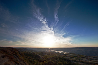 The solitude of sunrise on the edge of the Dry Island Buffalo Jump. Mist was floating above the Red Deer River. Clouds swirled around the rising sun and spirits of the past danced in the sparkling sunlight.