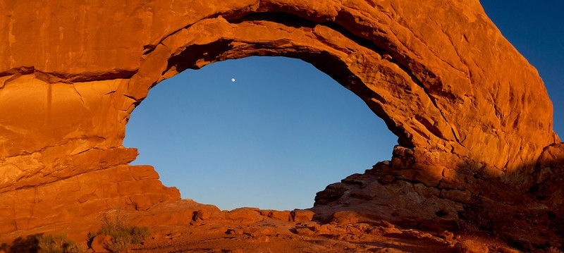 South Window & Moonrise - Arches National Park, UT<br /> <br /> Frame Your Subject<br /> <br /> Using other natural features in your image, try to frame your subject.  The framing can be completely subtle--see Figure 5a.  It can be quite obvious like something in the opening of an arch as this image shows.  There's a moon in that arch.  The object here as with using leading lines is to keep the viewer's eyes on the image.  Framing your subject will tend to keep you viewer's eyes more engage with your image.