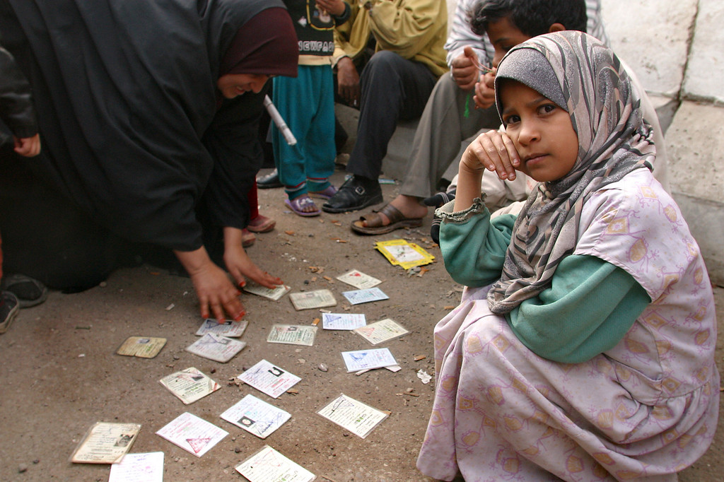 """<em>(Photo by Linda Panetta) Baghdad, 2004: Uncertainty in a time of war. A mother and child displays ID cards of family members who have 'disappeared'. They are not sure if they have been imprisoned, killed or have fled the violence.</em> <center> -----------</center> March 15, 2009 <h2><span style=""""color:#CC9900"""">Tales from Torture's Dark World</h2></span> <em><span style=""""color:#CCCCCC"""">By Mark Danner</em>   Adapted from a longer article, for the New York Review of Books, about the ICRC Report on the Treatment of Fourteen """"High Value Detainees"""" in CIA Custody.    ON a bright sunny day two years ago, President George W. Bush strode into the East Room of the White House and informed the world that the United States had created a dark and secret universe to hold and interrogate captured terrorists.   """"In addition to the terrorists held at Guantánamo,"""" the president said, """"a small number of suspected terrorist leaders and operatives captured during the war have been held and questioned outside the United States, in a separate program operated by the Central Intelligence Agency.""""   At these places, Mr. Bush said, """"the C.I.A. used an alternative set of procedures."""" He added: """"These procedures were designed to be safe, to comply with our laws, our Constitution and our treaty obligations... <a href=""""http://www.markdanner.com/articles/show/152"""" target=""""_blank""""><em>Read complete article.</a></em> </span>"""