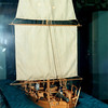 Model of Philadelphia on display in a glass case. Bow view.