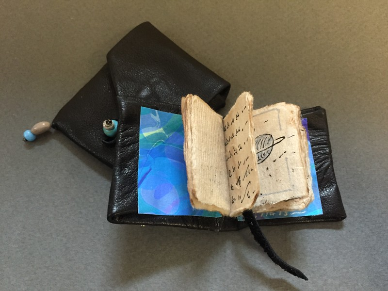 Miniature book (with eye on cover), open