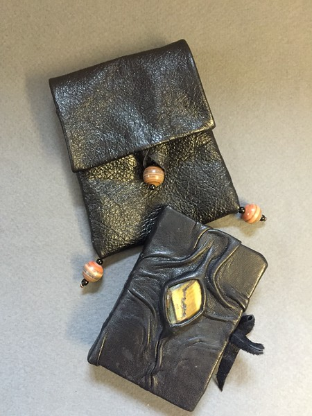 Sculptural leather miniature book with leather  pouch