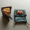 Miniature leather book and pouch wtih bat on flap
