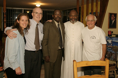 A late night celebratory gathering following Fr. (Gerry) Jean-Juste's release from one of Haiti's most deplorable prisons. Fr. Gerry was a political prisoner unjustly imprisoned in an attempt to silence his advocacy work with the poor. (From the left) Linda Panetta, human rights lawyers Bill Quigley and Mario Joseph, Fr. Jean-Juste and Bishop Gumbleton. .