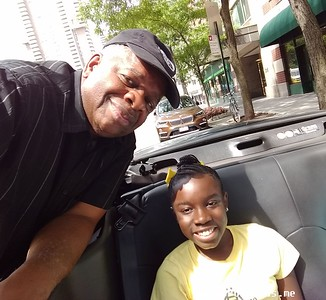 Gregory Burrus with Mikaili Ulmer of Mikaili and the Bees