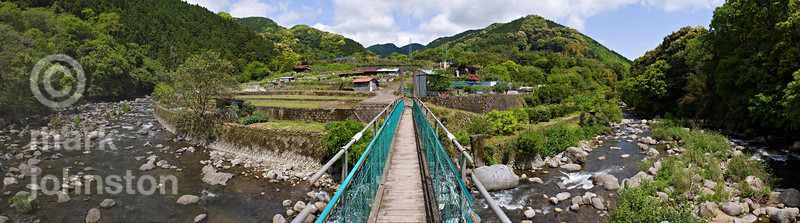 Suspended footbridge across the river in the mountains of the Izu Peninsula, Shizuoka Prefecture, Japan.