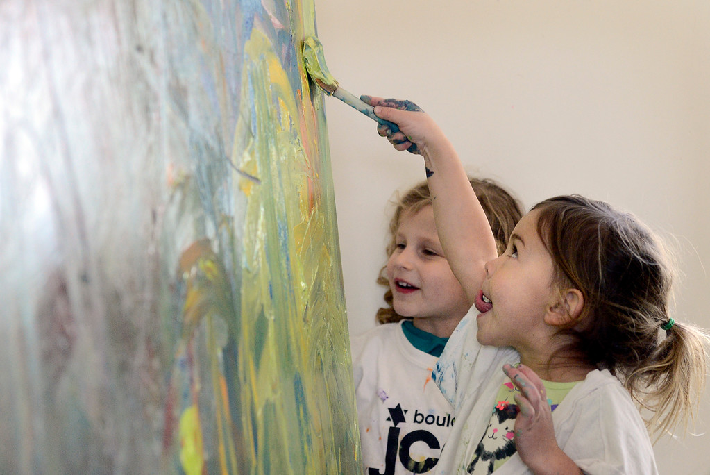 . Pre-K students Flynn, 4, at right, and Maya, 4, paint at the Jay and Rose Phillips Early Childhood Center inside the Boulder JCC on Wednesday. Jeremy Papasso/ Staff Photographer 12/06/2017
