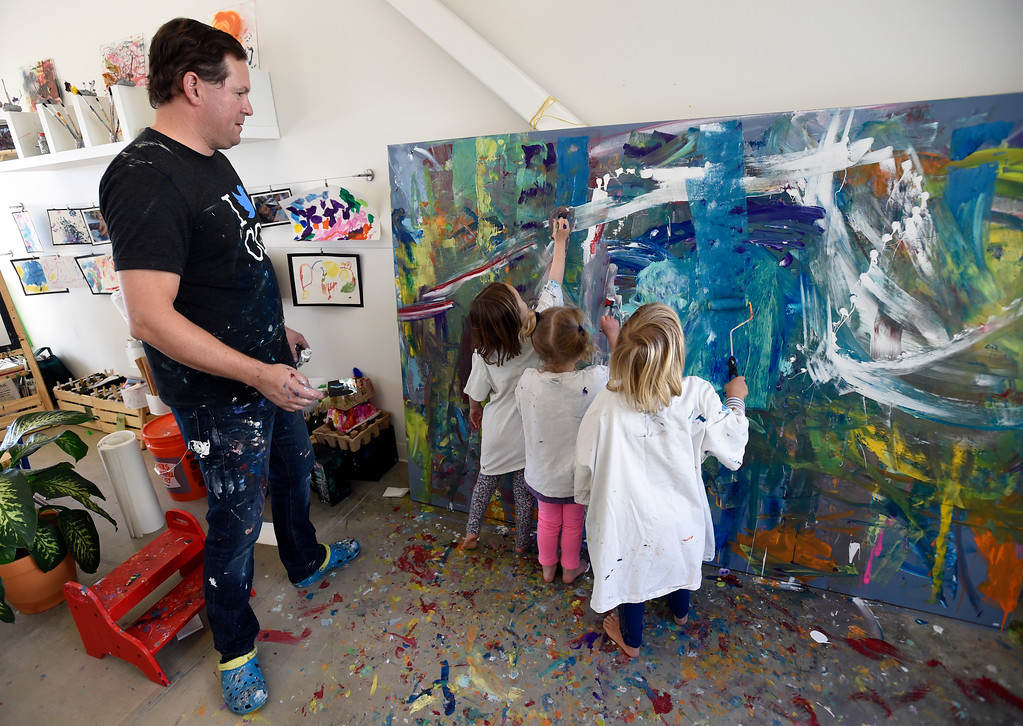. Artist Will Day paints with Pre-K students at the Jay and Rose Phillips Early Childhood Center inside the Boulder JCC on Wednesday. Jeremy Papasso/ Staff Photographer 12/06/2017