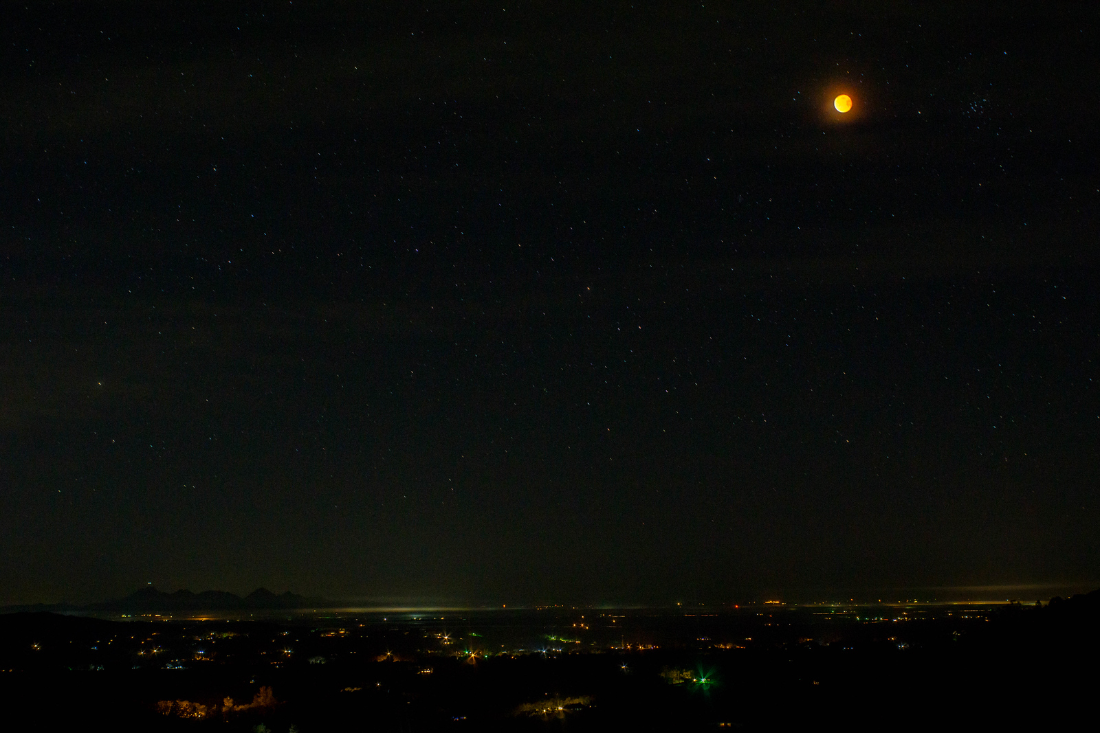Image of the super, blue, blood moon over Browns Valley CA. Sutter Buttes can be seen on the horizon in the distance.