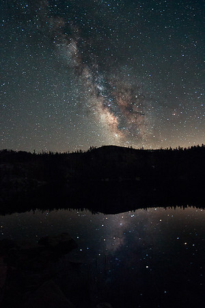 I went out for an overnight photo safari last Thursday, up to the Grouse Ridge area. I camped at Island Lake and took this incredible shot of the milky way reflected in the lake. There was no wind so it was like glass.