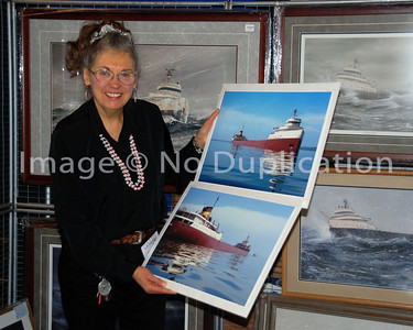 Doris holds giclee enlargements of the S.S. Edmund Fitzgerald that were taken in May, 1975, on the St. Mary's River by Michigan photographer, Robert Campbell.  The image at the top has been famous for decades.  In November, 2010, Campbell allowed first time ever release to Star of the North Studio of his afterend shot as the mighty Fitz passed by.  Twisting his body while the motor boat turned around, he discovered the end of the image had been chopped off.  Regardless, Doris felt this was an incredible, valuable and important image that would be appreciated by the followers of the Edmund Fitzgerald history, and now legend.  So Bob allowed first time release of both photos as a set for those who would like to own the whole photo story.  These images cannot be ordered via this website.   Contact directly:  doris.starofthenorth@gmail.com
