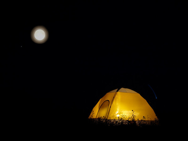 Camping on the prairies is the same as camping anywhere else. It's dark, who knows what's out there? Safety looks like a warm, bright tent.