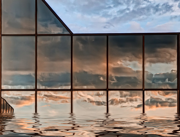 Water, glass & clouds.