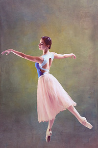 Cuban National ballerina standing en pointe  with both arms outstretched in old Havana Mansion, Cuba