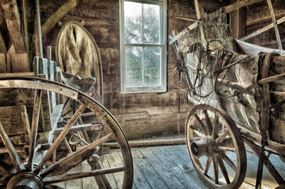 Covered wagon, wooden wagon wheel and other artifacts at the museum at Adams Mill, Cutler, Indiana