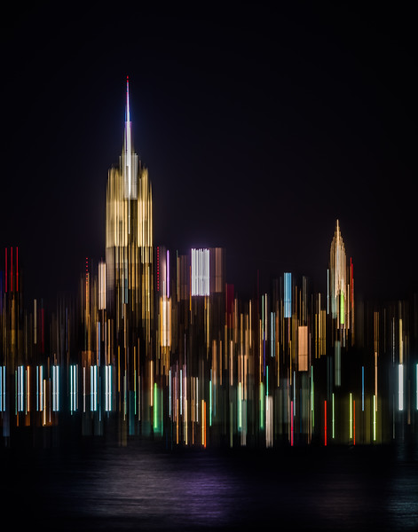 Abstract photography can be fun. We can see everyday locations in a different manner but still be somehow identifiable. Here the way the lines are located show the top of the Empire State and Chrysler buildings in a recognizable manner. We can also some of the buildings lights reflecting in the Hudson.