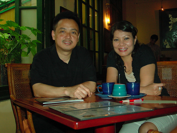 I recently had coffee with Dung and his  lovely wife Anh in a quaint coffee shop in the old quarter of Hanoi.  There they told me a bit about their life and dreams. <br /> <br /> Dungs father was a poet and his mother, a physician - he was the youngest of their four children.  Dung and Anh have one son, Quang.  He is 13 and attends the international school in Hanoi.  He loves soccer, playing the drums and studying math and science.  <br /> <br /> Anh is a stay at home mother who enjoys  traveling, listening to music, cooking and playing the viola.<br /> <br /> Dung is truly quiet.  When he is not painting, he loves listening to European classical music and playing classical guitar.  When he paints, he paints in silence and finds himself in a peaceful and meditative state.  Dung's paintings are carefully composed and balanced with emptiness.  He enjoys painting landscapes and figurative works - in fact, the familiar image he often paints of a boy holding a leaf is inspired by memories of his own son as a young child.