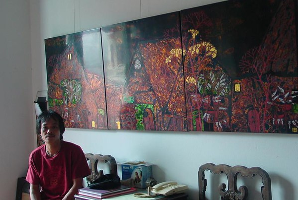 Tuan in his studio in May with a recently completed triptych destined for exhibition in Thailand.