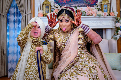 Here's to a Fun Friday!  Bride with her nephew before leaving home for the ceremony. or @amrithadhatt and Adam @fitnesshalpers wedding . @anaisevents @eyebrowthreadingbypreet @merisakhicreation , #halpergotdhatt #anaisevents  #mpsinghphotography