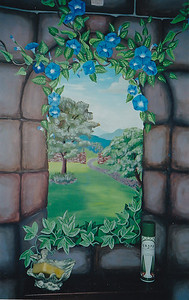 faux stone mural with window viiew, ivey and morning glories call for mural  pricing 843-997-9917 aprilbensch@sc.rr.com