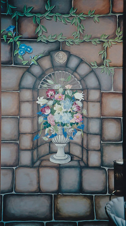 faux stone mural with wall inset, floral urn and creeping morning glories call for mural pricing 843-997-9917 aprilbensch@sc.rr.com
