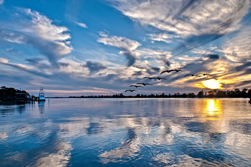 """Name: Blue Pelican Sunset - Pawleys Island, SC<br /> Medium: Photography<br /> Size: <br /> Price: $<br /> Contact: Mike Covington<br /> E-Mail: mike@lowcountryphotos.com <br /> For a print of this work, go to  <a href=""""http://www.lowcountryart.org"""">http://www.lowcountryart.org</a>"""