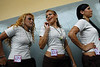 Inmates prepare to parade during a beauty pageant at the Talavera Bruce prison, Rio de Janeiro, Brazil, November 24, 2009. A jury elects the most beautiful among 15 contestants of three prisons in a beauty pageant held at the Talavera Bruce prison. The Miss Talavera Bruce Beauty Pageant is an important break from the routine life of about 330 female inmates in the maximum security prison. The Rio de Janeiro prison is a notorious Bangu area, where some of Rio's top drug traffickers are held. The fifth annual pageant, which the VivaRio non-governmental organization helps organize, tries to transform these dangerous criminals into beautiful, dazzling, beauty pageant hopefuls for one day. (Austral Foto/Renzo Gostoli)
