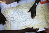 Italian-born artist Vanessa Beecroft looks at a map of the region of the miisions of the Diocess of Rumbek, Southern Sudan, November 2005. South Sudan has been negatively affected by the First and Second Sudanese Civil Wars for all but 10 years since independence in 1956, resulting in serious neglect, lack of infrastructure development, and major destruction and displacement. More than 2 million people have died, and more than 4 million are internally displaced or have become refugees as a result of the civil war and war-related impacts. The Jan. 9. 2005 peace accord granted the region autonomy and as part of that, Southern Sudan is scheduled to have a referendum on independence in 2011(Australfoto/Douglas Engle)