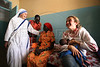 Italian-born artist Vanessa Beecroft visits orphans at a mission of the Diocess of Rumbek, Southern Sudan, November 2005. South Sudan has been negatively affected by the First and Second Sudanese Civil Wars for all but 10 years since independence in 1956, resulting in serious neglect, lack of infrastructure development, and major destruction and displacement. More than 2 million people have died, and more than 4 million are internally displaced or have become refugees as a result of the civil war and war-related impacts. The Jan. 9. 2005 peace accord granted the region autonomy and as part of that, Southern Sudan is scheduled to have a referendum on independence in 2011(Australfoto/Douglas Engle)