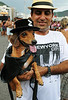A dog dressed in a carnival costume, as the Zorro, takes part in the animals carnival, Copacabana, Brazil, February 3, 2013. (Austral Foto/Renzo Gostoli)
