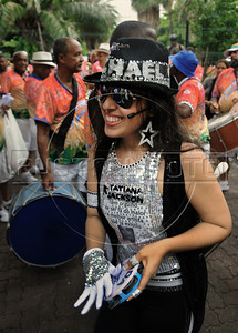 A reveler dressed as Michael Jackson performs during a carnival parade of the traditional Banda de Ipanema in a Ipanema's street, Rio de Janeiro, Brazil, January 26, 2013. Hundreds gathered for the annual 'Band of Ipanema' samba parades through the beachfront, the city's most famous street party of the year. (Austral Foto/Renzo Gostoli)